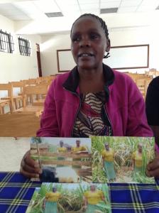 Bild 1: Janet är numera sockerrörsodlare och grisfarmare som ett resultat av den uppmuntran hon fått via Kibreliarbetet.